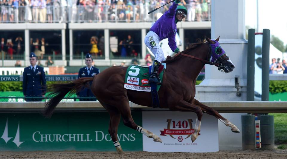 California Chrome, ridden by Victor Espinoza, crosses the finish line to win the 140th Kentucky Derby at Churchill Downs on May 3, 2014, in Louisville, Kentucky.