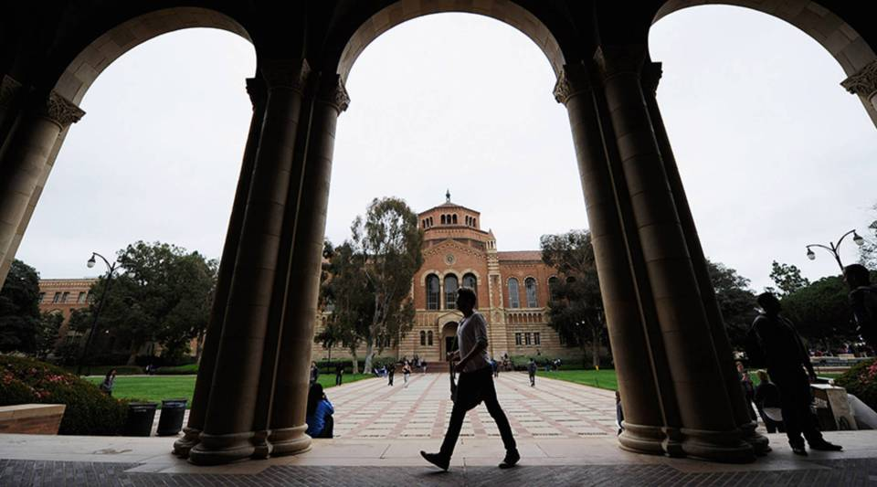 A student walks near Royce Hall on the UCLA campus.