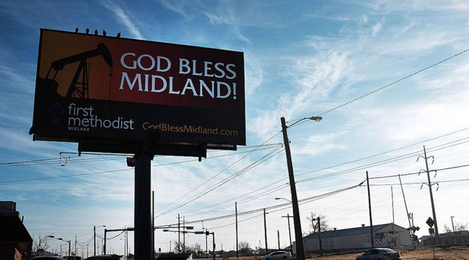 A billboard promotes the oil industry along a road in Midland on February 6, 2015 in Midland, Texas.