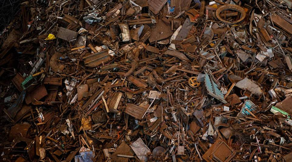 Scrap metal to be used in steel production is piled at the Zhong Tian (Zenith) Steel Group Corp. in 2016 in Changzhou, Jiangsu.