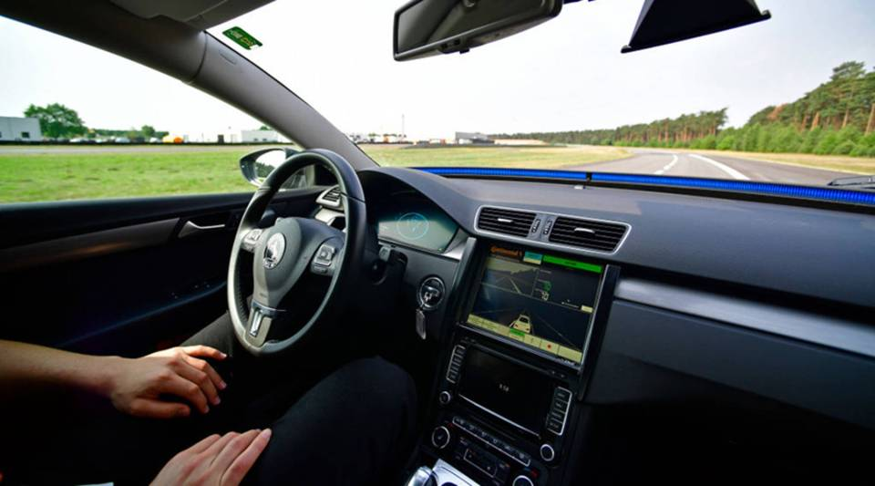 A driver presents a Cruising Chauffeur, a hands free self-driving system designed for motorways during a media event by Continental to showcase new automotive technologies on June 20, 2017 in Hannover, Germany.