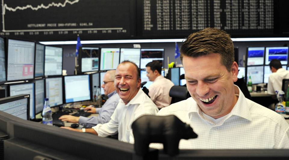 Though work friendships can provide emotional support, they can also be a distraction, says Nancy Rothbard of the Wharton School. Above, stock brokers laugh at Frankfurt's stock exchange.