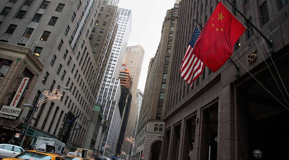 The flag of the People's Republic of China hangs next to an American flag in New York.