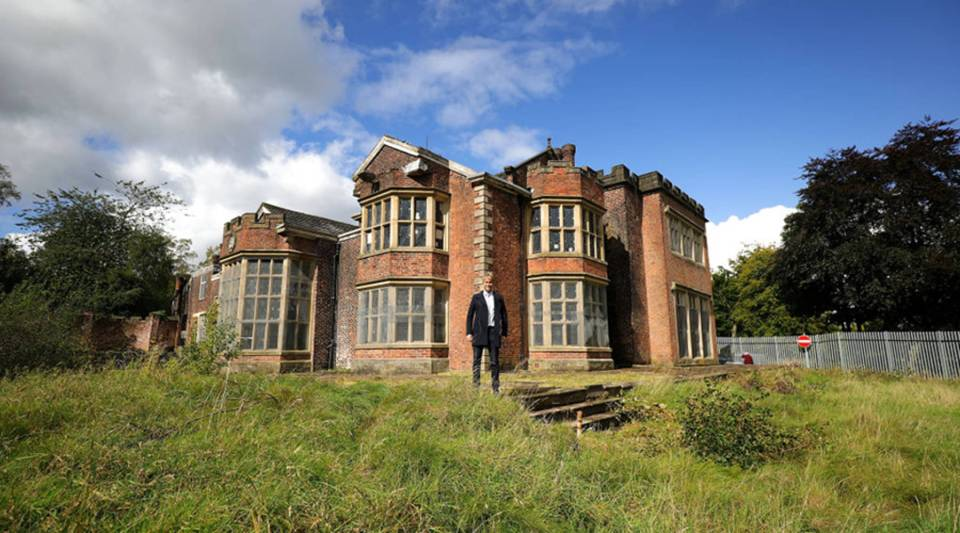 U.S. film actor Hopwood DePree stands outside Hopwood Hall, his family's ancestral home near the town of Rochdale in northern England, in September 2017. He hopes to restore it.