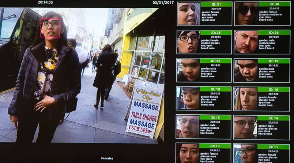 A display shows a facial recognition system for law enforcement during the NVIDIA GPU Technology Conference in Washington, D.C., in 2017.
