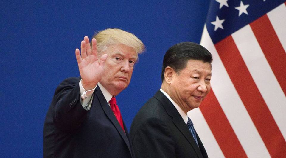President Donald Trump and China's President Xi Jinping leave a business leaders event at the Great Hall of the People in Beijing on Nov. 9, 2017.