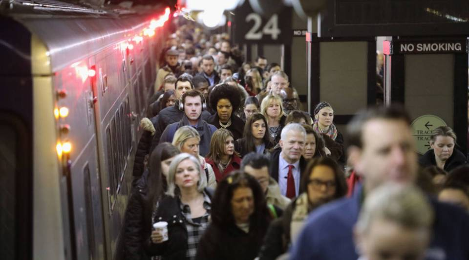 People arrive on a commuter train to Grand Central Terminal on December 12, 2017 in New York City.