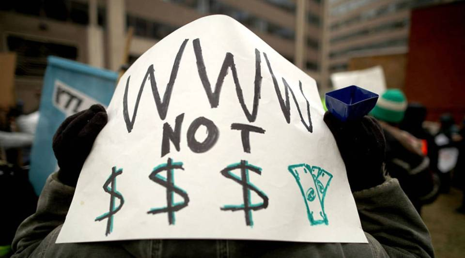 Demonstrators outside the Federal Communications Commission building in Washington, D.C., in December protest the end of net neutrality rules.
