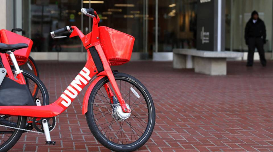 A Jump bike sits in front of Uber headquarters in San Francisco. Uber acquired Jump for an undisclosed amount of money.