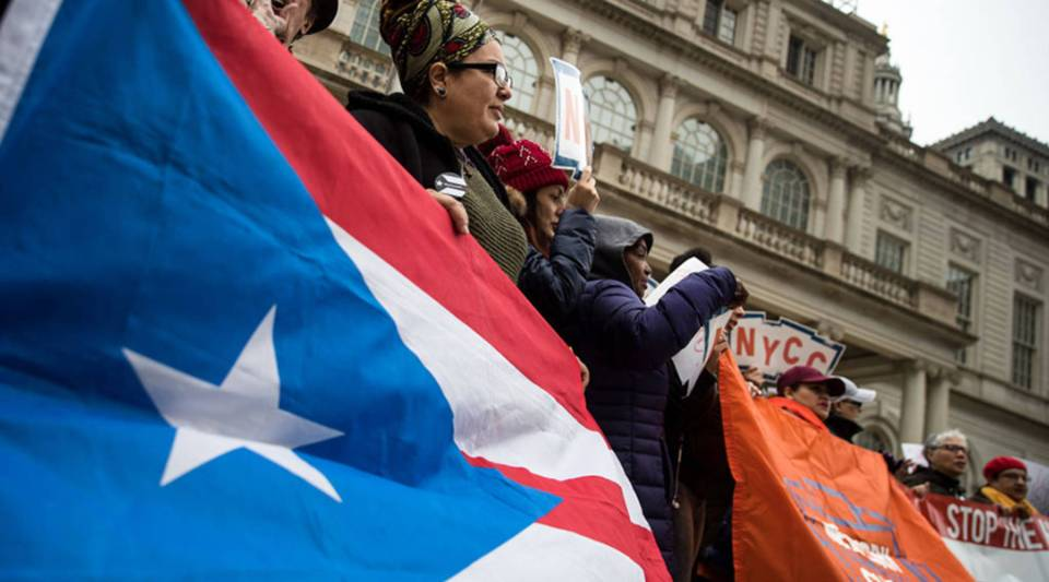 Activists rally in support of Puerto Rican families displaced by Hurricane Maria on the steps of New York City Hall in April.