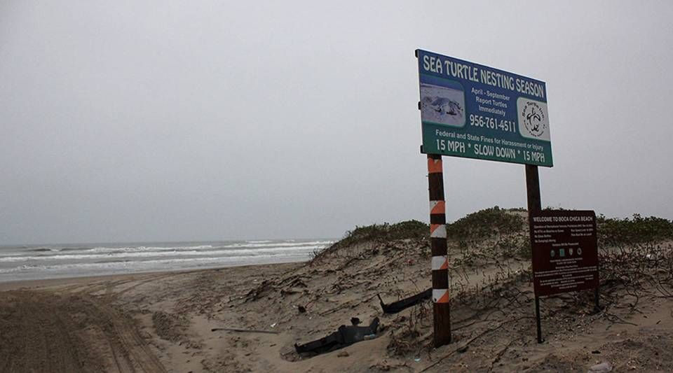 The popular Boca Chica Beach sits at the end of Texas Highway 4, less than a half mile from SpaceX's launch facility.