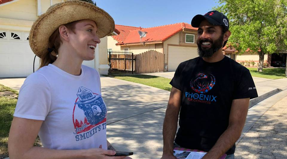 Jess Phoenix and husband Carlos canvass a Lancaster neighborhood ahead of the June 5 primary.