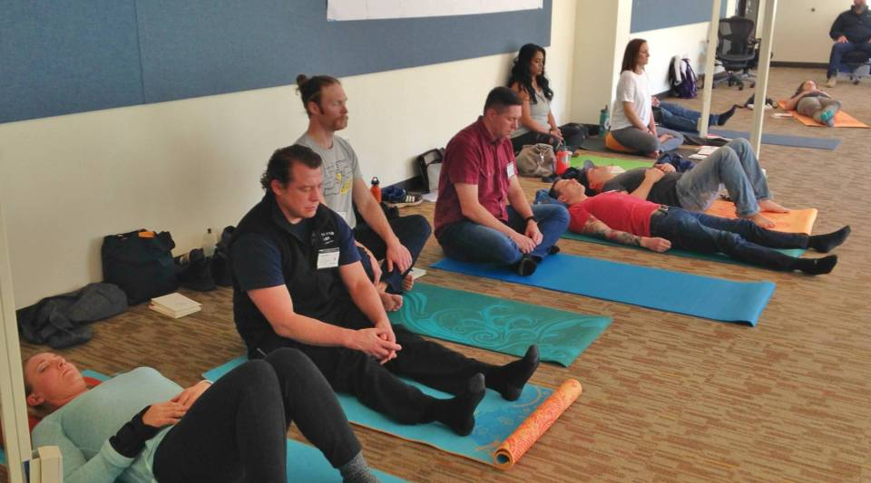 First responders practice guided meditation as part of Richard Goerling's mindfulness workshop in Hillsboro, Oregon.