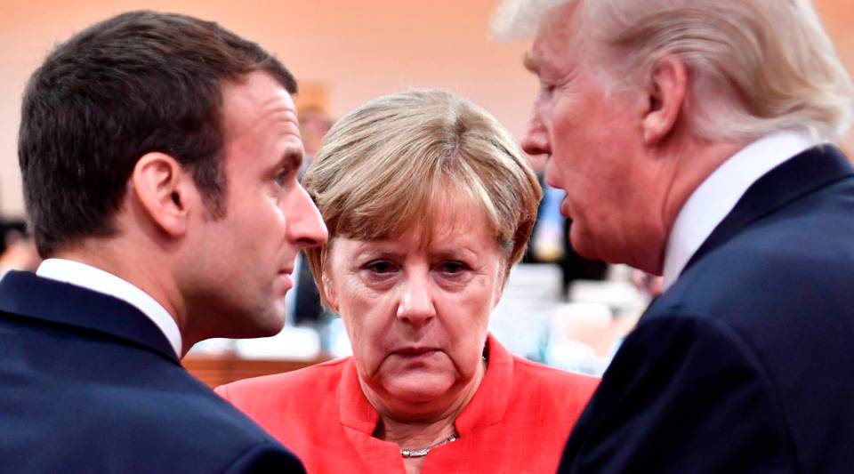 French President Emmanuel Macron, German Chancellor Angela Merkel and U.S. President Donald Trump conferring at last year's G20 meeting, a gathering of the world's top economies.