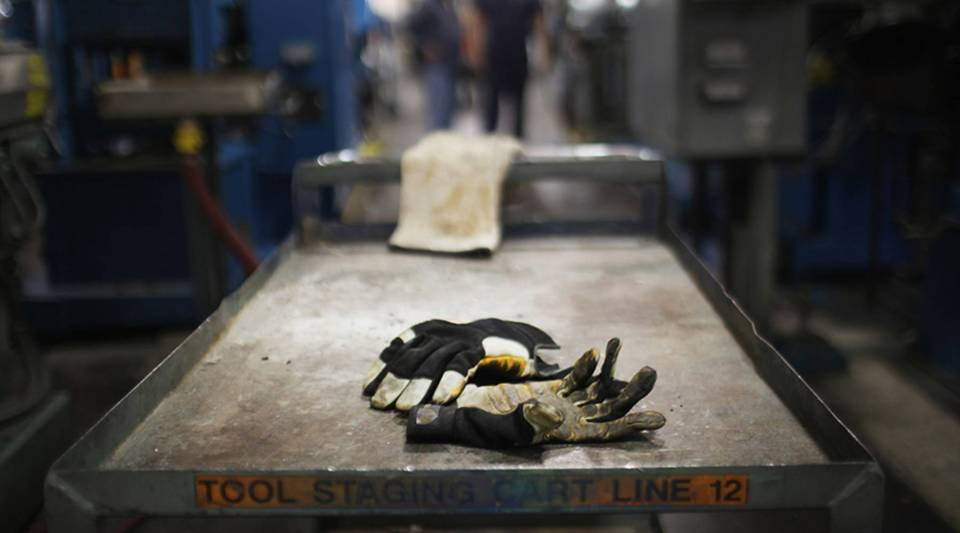 Work gloves are viewed on the factory floor at Quadrant, a high-end plastic processor, in Reading, Pennsylvania, in 2011.
