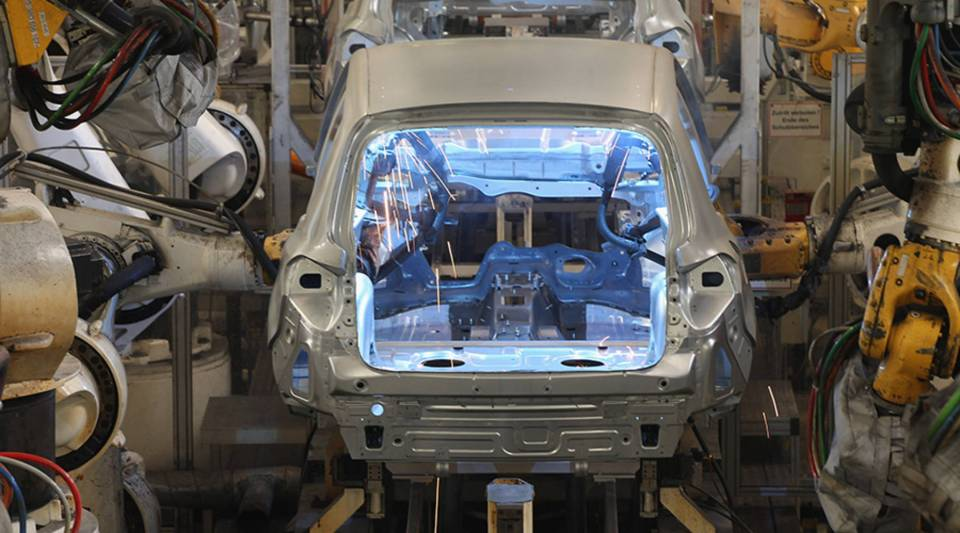 Robots weld the bodies of Volkswagen Tiguans at the Volkswagen factory in 2012 in Wolfsburg, Germany.