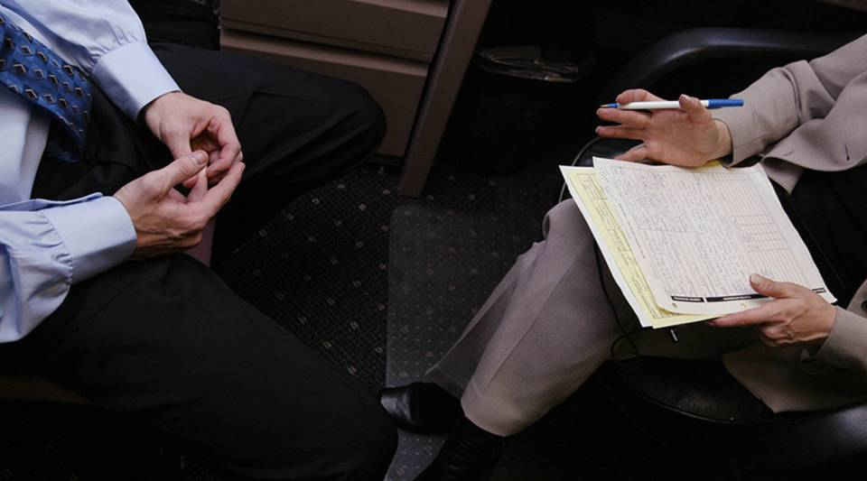 A job applicant speaks with a recruiter during an interview in New York City.