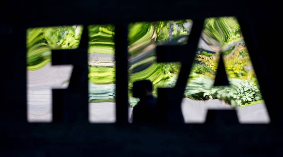 A FIFA logo sits next to the entrance at the FIFA headquarters on June 3, 2015 in Zurich, Switzerland.