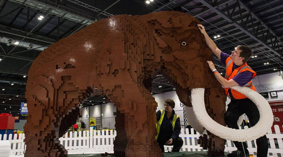 "Husband and wife Annie and Ed Diment put the final bricks in place on their 400,000-piece ""Ice Age"" display at a Lego exhibition in London in 2015. The woolly mammoth took nine weeks to build."