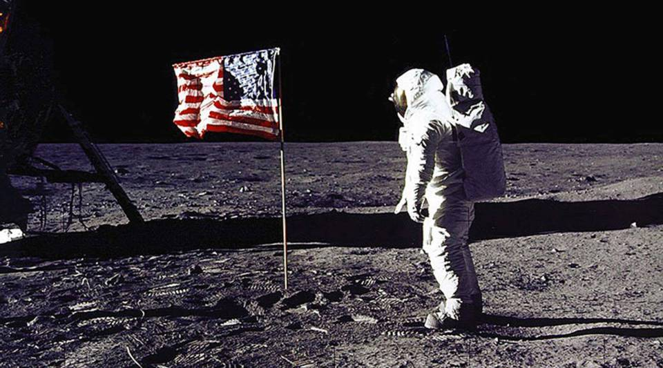 "Astronaut Edwin E. ""Buzz"" Aldrin Jr. salutes the U.S. flag on the surface of the moon during the Apollo 11 mission on July 20, 1969."