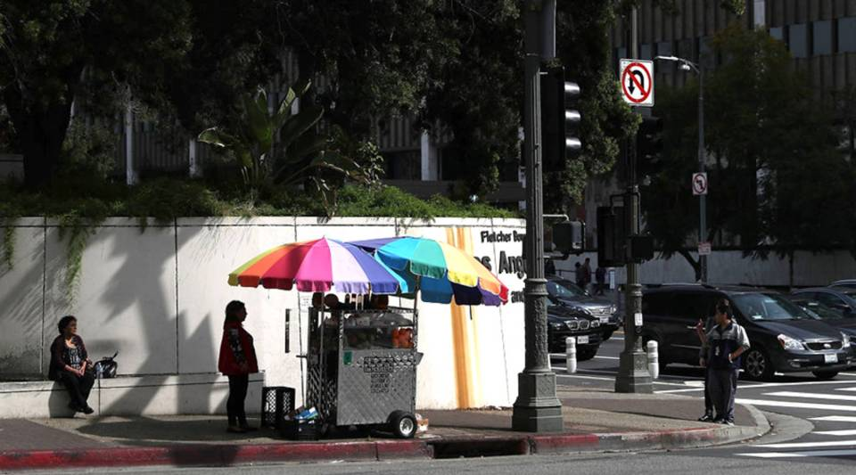 A street vendor sells fruit in Los Angeles in 2017. It's the only major U.S. city where street vending is illegal.