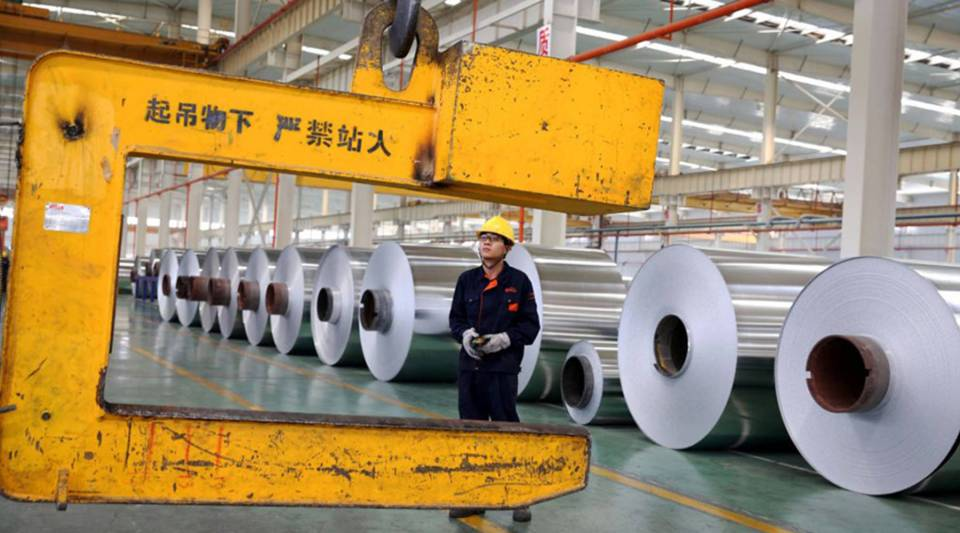 A Chinese worker loads aluminium tapes at a plant in Huaibei, in east China's Anhui Province, in 2017.