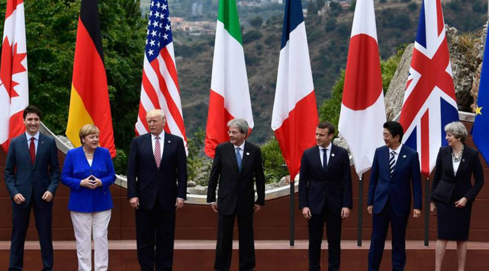 From left, Canadian Prime Minister Justin Trudeau, German Chancellor Angela Merkel, U.S. President Donald Trump, Italian Prime Minister Paolo Gentiloni, French President Emmanuel Macron, Japanese Prime Minister Shinzo Abe and British Prime Minister Theresa May pose for a photo at the ancient Greek Theatre of Taormina at the 2017 G-7 summit in Sicily.