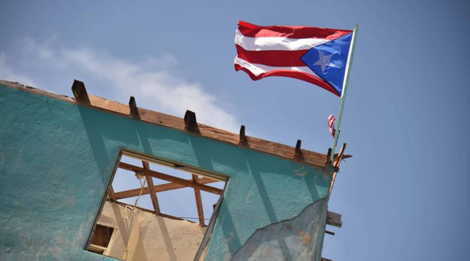 A flag of Puerto Rico is seen on a damaged house in Yabucoa, in eastern Puerto Rico, on Sept. 28, 2017.
