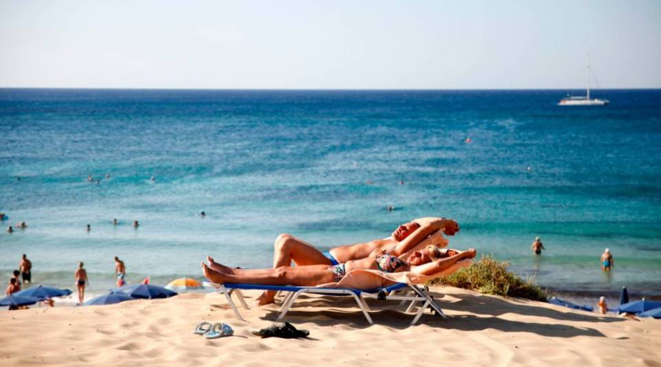 Maybe your dream vacation spot is in Cyprus, like for this sunbathing couple.