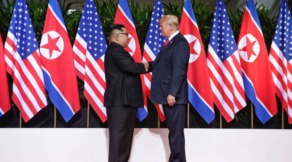 North Korean leader Kim Jong Un, left, shakes hands with U.S. President Donald Trump during their historic summit at the Capella hotel on Sentosa Island on June 12 in Singapore.