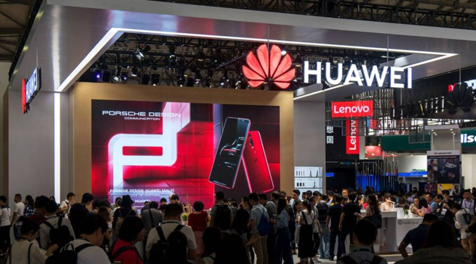 People gather at a Huawei stand during the Consumer Electronics Show Asia in Shanghai on June 13.