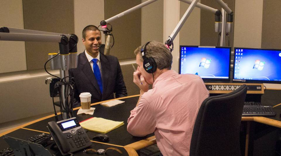 FCC Chairman Ajit Pai, left, is interviewed by Marketplace host Kai Ryssdal on June 11.
