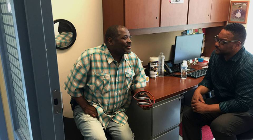 Sidney Bond (left) meets with peer recovery specialist Nathan Thomas at Baltimore's Health Care for the Homeless.
