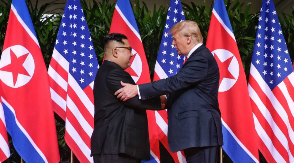 North Korean leader Kim Jong Un, left, shakes hands with U.S. President Donald Trump during their historic summit at the Capella Singapore hotel on Sentosa Island on Tuesday.
