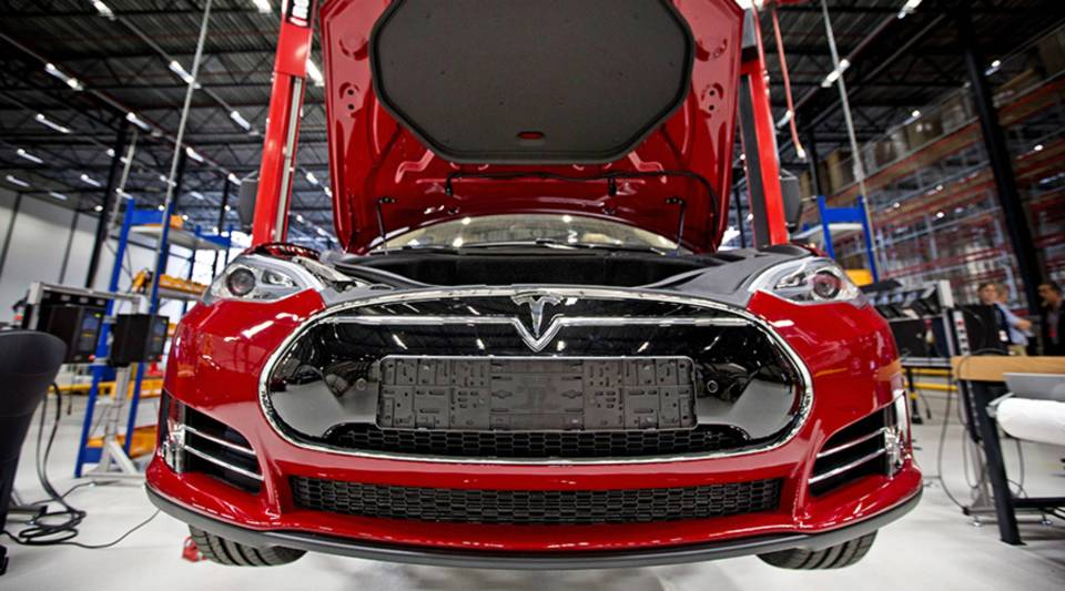 A view of a fully electric Tesla car on an assembly line at the new Tesla Motors car factory in Tilburg, the Netherlands, during the opening and launch of the new factory, on Aug. 22, 2013.