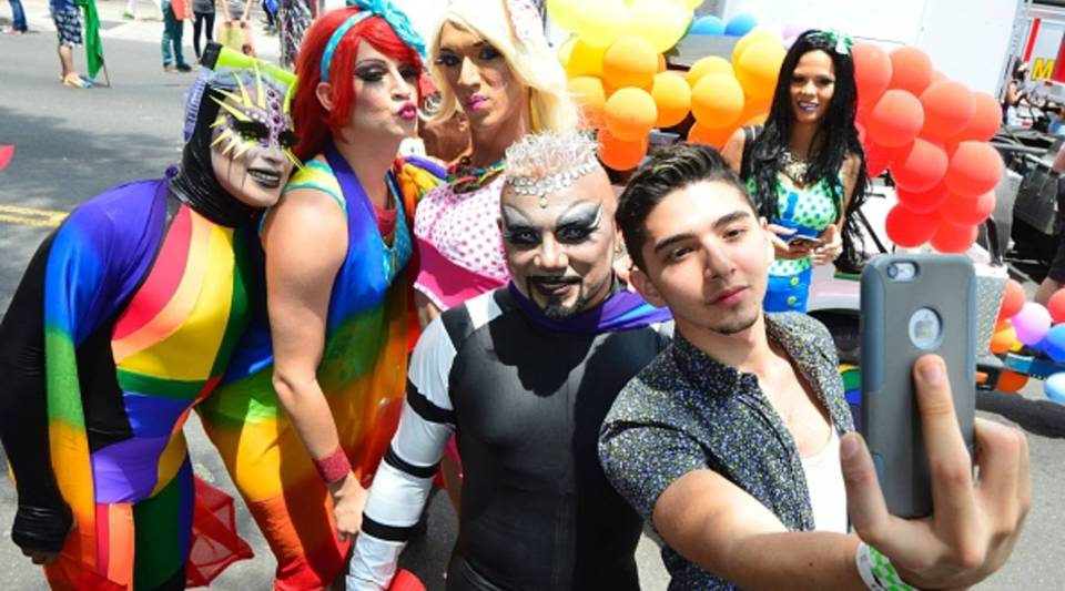 Revelers pose for a selfie as they take part in the Gay Pride Parade in San Jose on June 26, 2016.