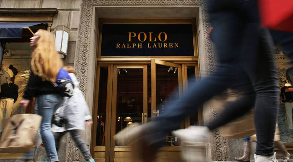People walk by Ralph Lauren's Fifth Avenue Polo store on April 4, 2017 in New York City.