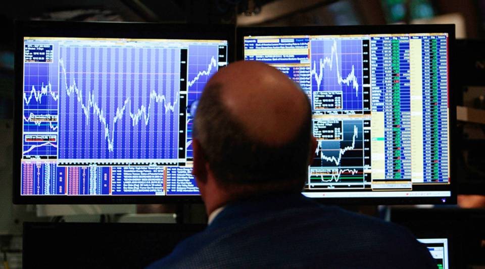 A financial professional loosk at his computer screen on the floor of the New York Stock Exchange at the end of the trading day Dec. 16, 2008 in New York City.