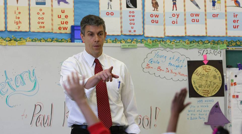 Then-Education Secretary Arne Duncan talks with second-graders at Paul Revere Elementary school in San Francisco in 2009
