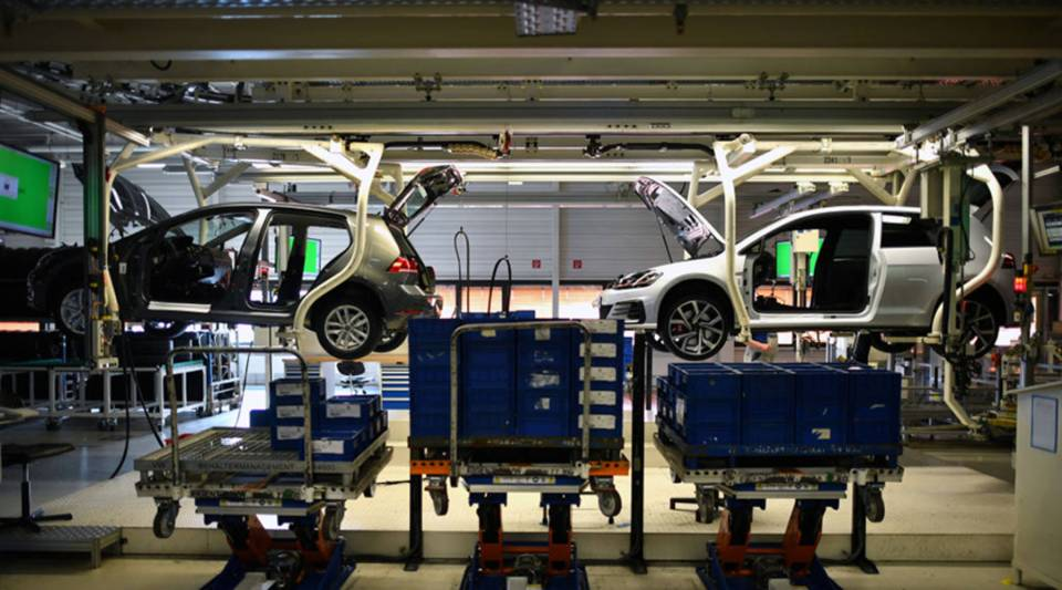 Volkswagen Golfs hang on the assembly line at the company's factory in Wolfsburg, Germany, in March.