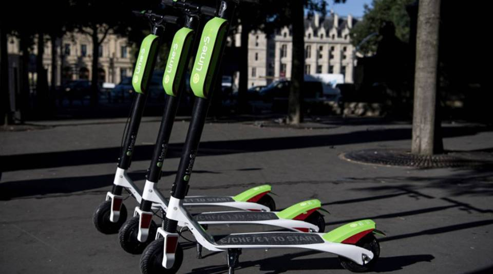 Electric scooters of the US company Lime are pictured on a sidewalk in Paris during their launching day on June 22, 2018.