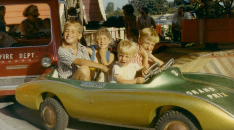 Author Richard Ratay gets first chance behind the wheel during a family road trip to Santa's Village in East Dundee Illinois in 1972. He is joined by his sister, Leslie, and two brothers, Mark (rear seat) and Bruce.