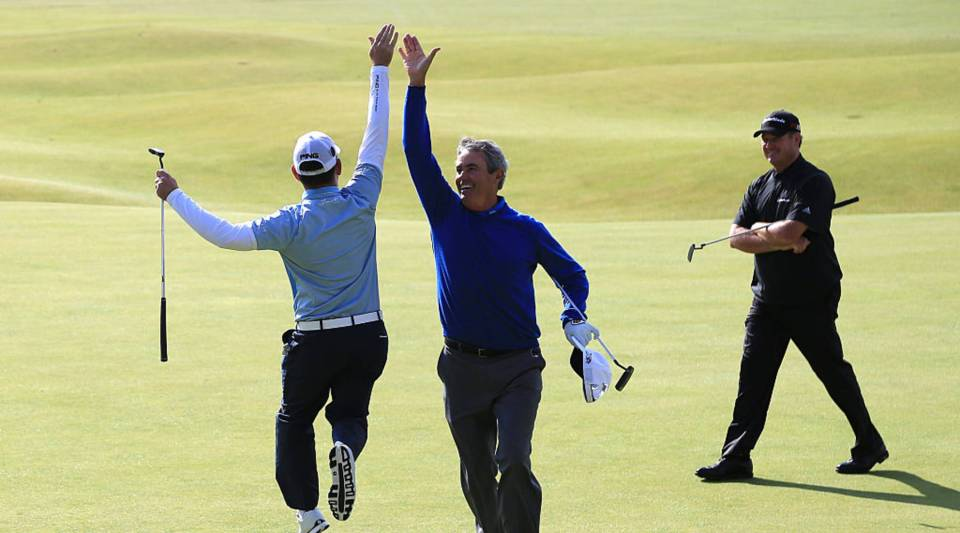 """A 5-hour workday at the financial services firm Collins SBA has given employees more time to devote to their hobbies — like golf. Pictured: Ian Baker-Finch of Australia and Louis Oosthuizen of South Africa """"high five"""" on the 18th green as Todd Hamilton of the United States looks on during the Champion Golfers' Challenge."""
