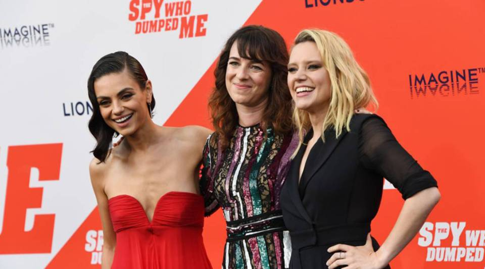 """Actress Mila Kunis, left, writer/director Susanna Fogel and actress Kate McKinnon arrive for the premiere of Lionsgate's """"The Spy Who Dumped Me"""" at the Fox Village Theater in Los Angeles on July 25."""