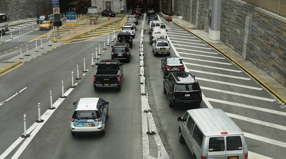 Cars drive toward the Lincoln Tunnel on July 30 in New York City.