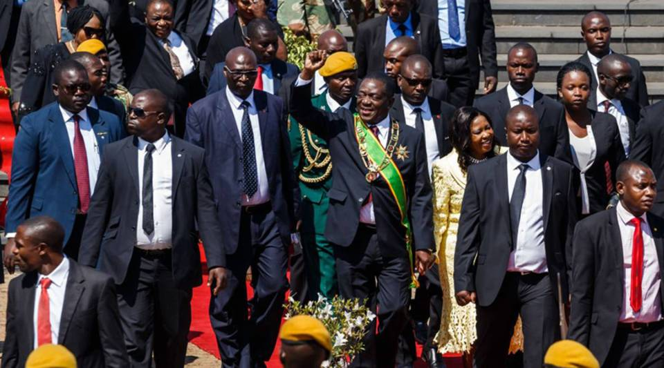 Zimbabwe President Emmerson Mnangagwa, center, salutes during the Heroes Day commemorations held at the National Heroes Acre in Harare today.