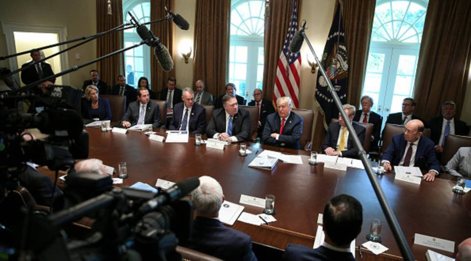 US President Donald Trump, center, hosts a cabinet meeting in the Cabinet Room of the White House on Aug. 16, 2018 in Washington, DC.