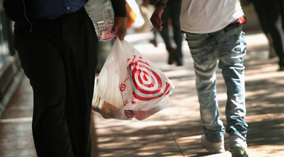 A shopper carries away his purchases from a Target store on Aug. 22, 2018 in Chicago, Illinois. Target today reported a 6.4 percent jump in store traffic for the quarter, the biggest increase in at least a decade. The retailer also reported a 41 percent increase in online sales for the quarter.