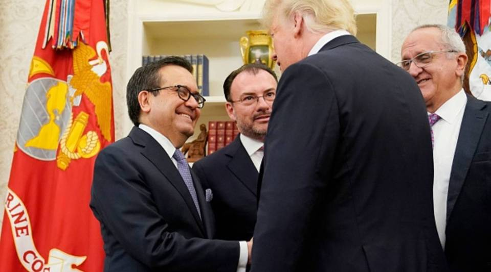 U.S. President Donald Trump shake hands with Mexico's Economy Minister Ildefonso Guajardo Villarreal in the Oval Office of the White House in Washington, D.C., today.