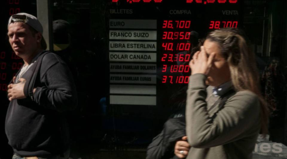 Currency exchange values are displayed in the buy-sell board of a bureau de exchange in Buenos Aires, on August 29, 2018. - Argentina's President Mauricio Macri said Wednesday that the International Monetary Fund has agreed to accelerate funding in support of his government's austerity program. The development came amid heightened volatility in the South American country's financial and currency markets, which have been battered by uncertainty over inflation, an economic downturn and budget deficits.